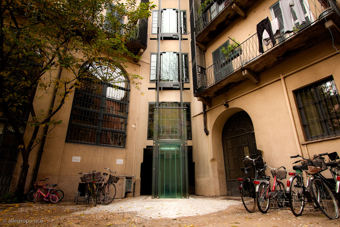Outdoor residential glass elevator in Inner Courtyard, Milan